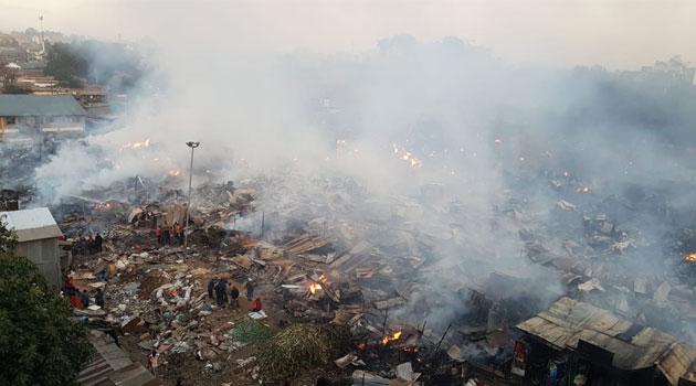 Huge fire destroys section of Toi market – PHOTOS